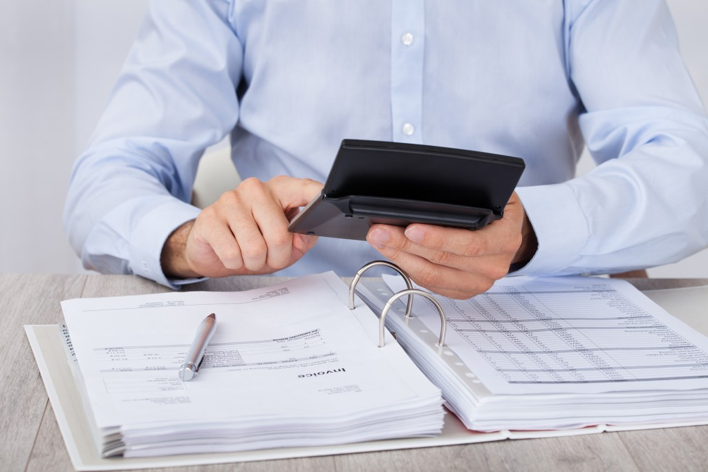 Businessman Calculating Financial Expenses
