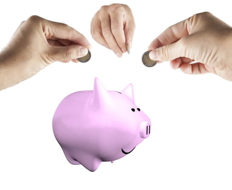 Male hands bringing money to a piggy bank, isolated over white